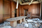 Semi-trashed wood paneled conference room